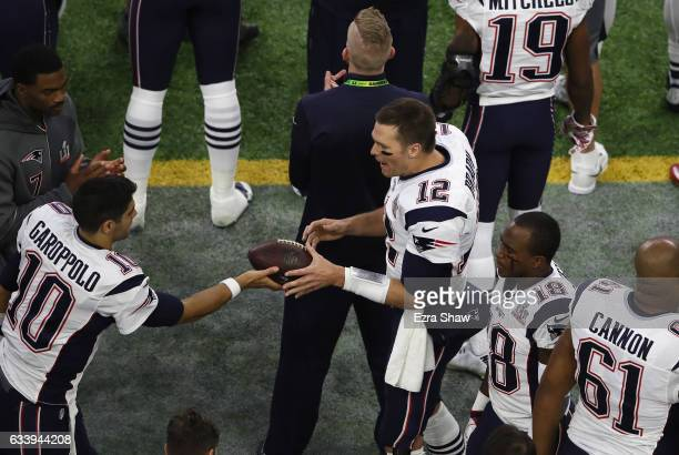 Tom Brady of the New England Patriots talks to Jimmy Garoppolo prior to Super Bowl 51 against the Atlanta Falcons at NRG Stadium on February 5 2017...