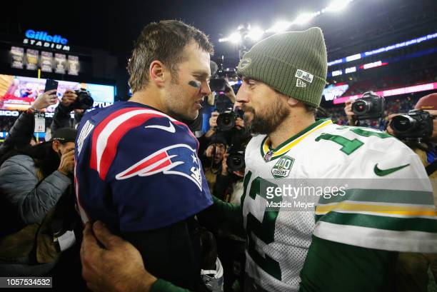Tom Brady of the New England Patriots talks with Aaron Rodgers of the Green Bay Packers after the Patriots defeated the Packers 3117 at Gillette...