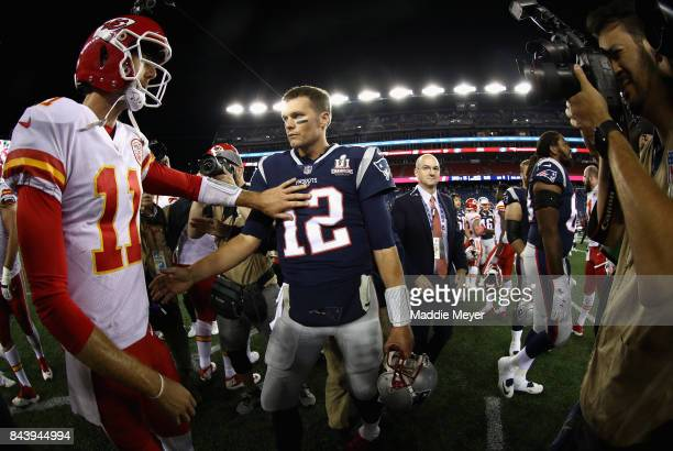 Tom Brady of the New England Patriots talks with Alex Smith of the Kansas City Chiefs after the Kansas City Chiefs defeated the New England Patriots...