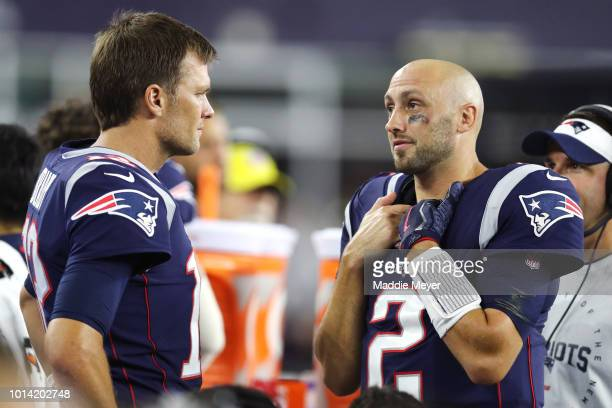 Tom Brady of the New England Patriots talks with Brian Hoyer during the preseason game between the New England Patriots and the Washington Redskins...