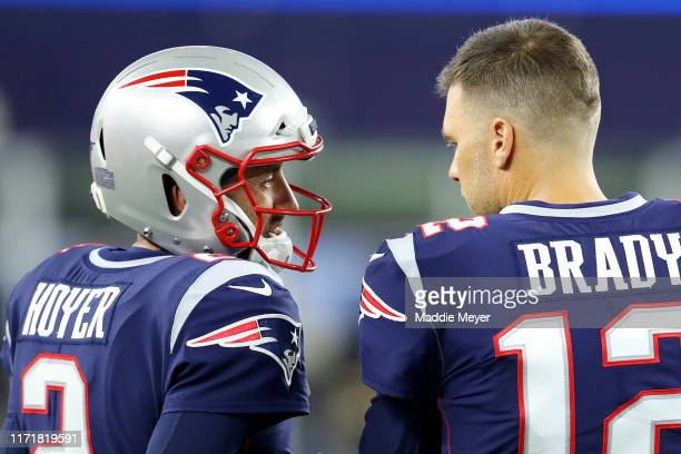 Tom Brady of the New England Patriots talks with Brian Hoyer during the preseason game between the New York Giants and the New England Patriots at...