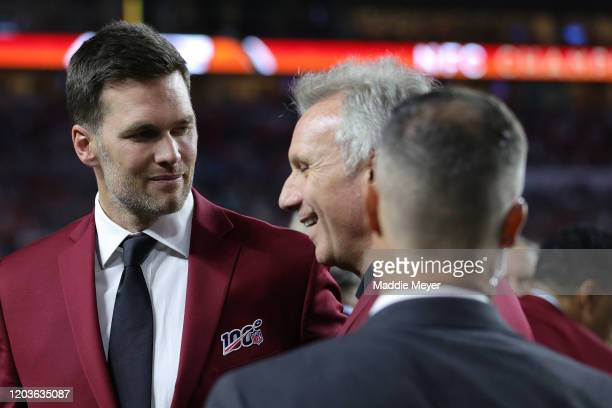Tom Brady of the New England Patriots talks with Hall of Famer Joe Montana prior to Super Bowl LIV between the San Francisco 49ers and the Kansas...