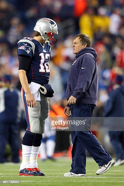Tom Brady of the New England Patriots talks with head coach Bill Belichick prior to the 2015 AFC Championship Game against the Indianapolis Colts at...