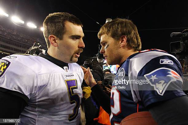 Tom Brady of the New England Patriots talks with Joe Flacco of the Baltimore Ravens after defeating the Baltimore Ravens in the AFC Championship Game...