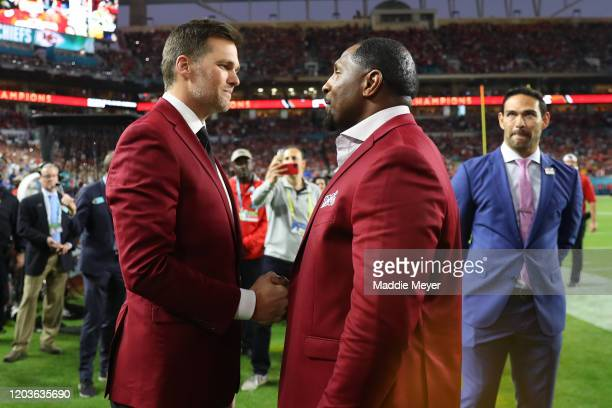 Tom Brady of the New England Patriots talks with NFL Hall of Famer Ray Lewis of the Baltimore Ravens prior to Super Bowl LIV between the San...