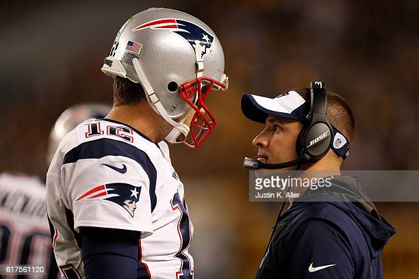 Tom Brady of the New England Patriots talks with Offensive Coordinator Josh McDaniels in the fourth quarter during the game against the Pittsburgh...