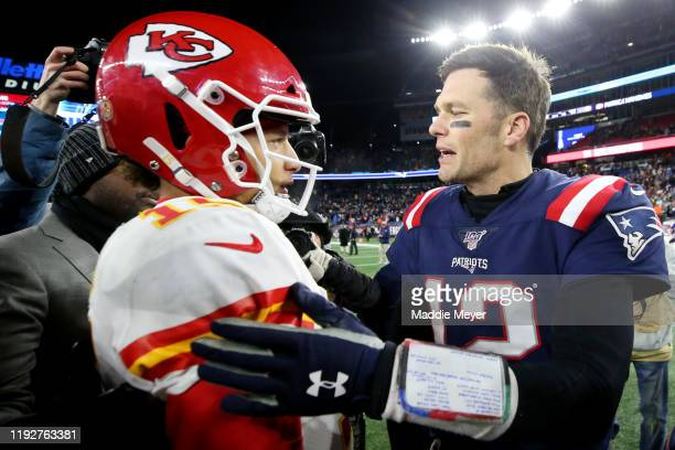Tom Brady of the New England Patriots talks with Patrick Mahomes of the Kansas City Chiefs after the Chief defeat the Patriots 23-16 at Gillette...