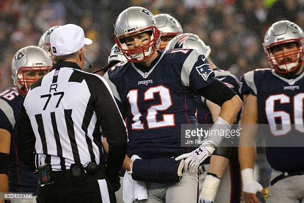 Tom Brady of the New England Patriots talks with referee Terry McAulay during the first half against the Pittsburgh Steelers in the AFC Championship...