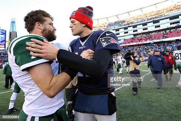 Tom Brady of the New England Patriots talks with Ryan Fitzpatrick of the New York Jets after the Patriots defeat the Jets 413 at Gillette Stadium on...
