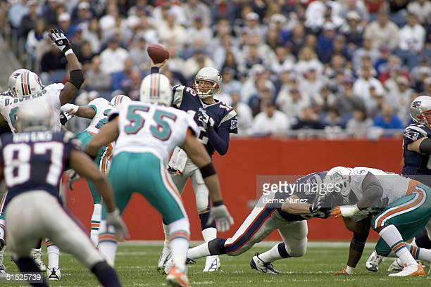 Tom Brady of the New England Patriots throwing a pass during the game against the Miami Dolphins at Gillette Stadium on October 10, 2004 in...