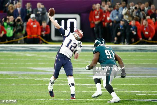 Tom Brady of the New England Patriots throws a pass against the Philadelphia Eagles during the fourth quarter in Super Bowl LII at US Bank Stadium on...