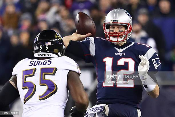 Tom Brady of the New England Patriots throws a pass as he is pressured by Terrell Suggs of the Baltimore Ravens during the first half of their game...