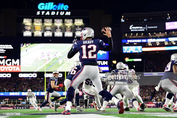 Tom Brady of the New England Patriots throws a pass during the first half against the Buffalo Bills in the game at Gillette Stadium on December 21,...