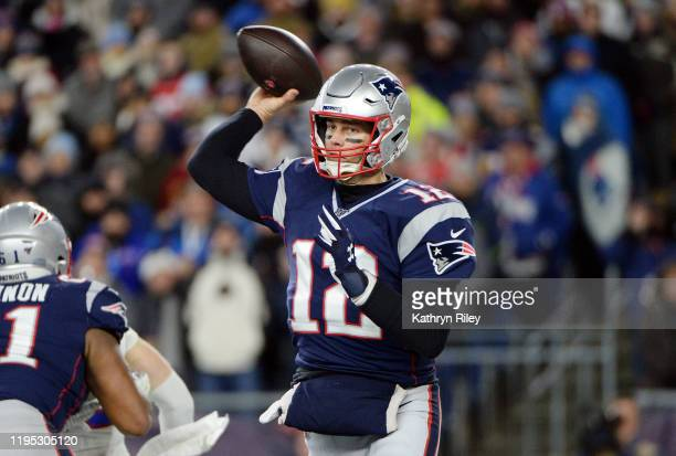 Tom Brady of the New England Patriots throws a pass during the first half against the Buffalo Bills in the game at Gillette Stadium on December 21...