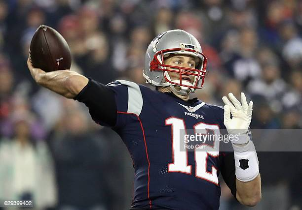 Tom Brady of the New England Patriots throws a pass during the first half against the Baltimore Ravens at Gillette Stadium on December 12 2016 in...