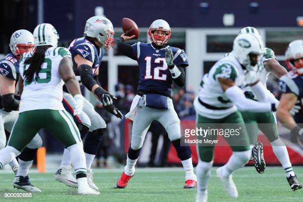 Tom Brady of the New England Patriots throws a pass during the first half against the New York Jets at Gillette Stadium on December 31 2017 in...