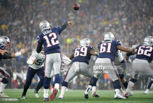 Tom Brady of the New England Patriots throws a pass during the second half against the Tennessee Titans in the AFC Wild Card Playoff game at Gillette...