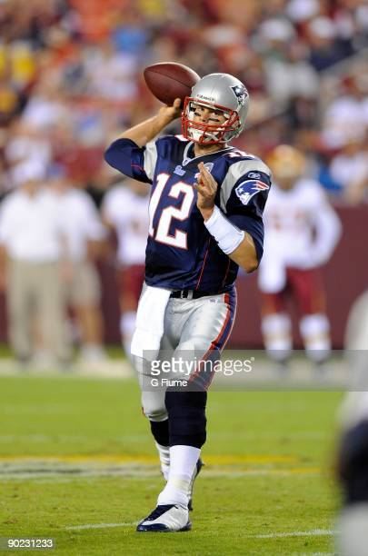 Tom Brady of the New England Patriots throws a pass in a preseason game against the Washington Redskins at FedEx Field on August 28 2009 in Landover...
