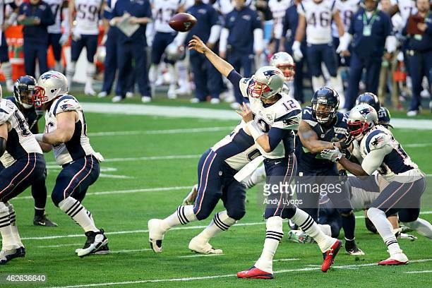 Tom Brady of the New England Patriots throws a pass in the first quarter during Super Bowl XLIX at University of Phoenix Stadium on February 1 2015...