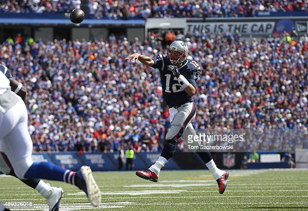 Tom Brady of the New England Patriots throws a touchdown pass during NFL game action against the Buffalo Bills at Ralph Wilson Stadium on September...