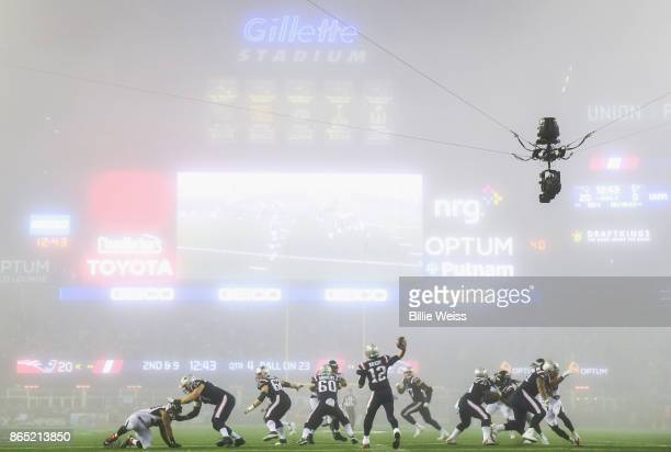 Tom Brady of the New England Patriots throws as fog falls on the field during the fourth quarter of a game against the Atlanta Falcons at Gillette...