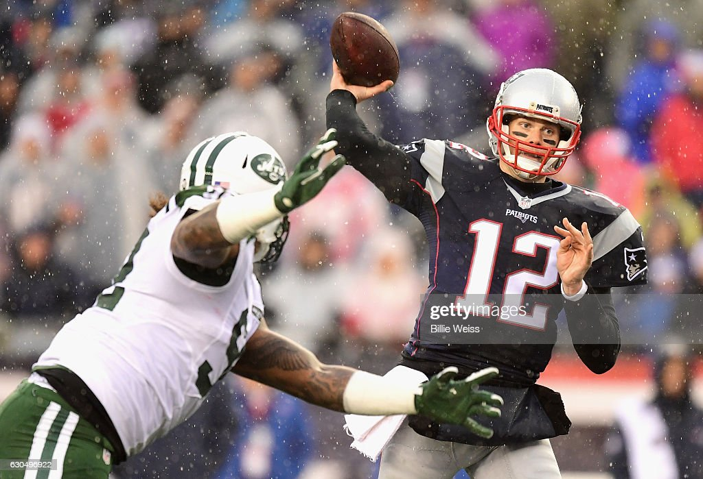 Tom Brady #12 of the New England Patriots throws during the first quarter of a game against the New York Jets at Gillette Stadium on December 24, 2016 in Foxboro, Massachusetts.