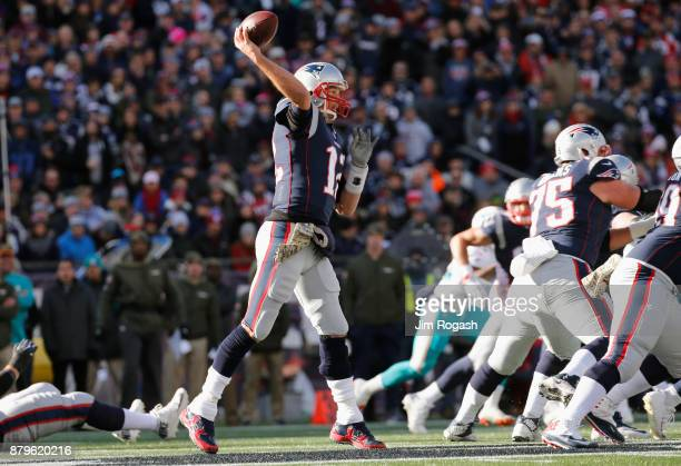 Tom Brady of the New England Patriots throws during the first quarter of a game against the Miami Dolphins at Gillette Stadium on November 26 2017 in...