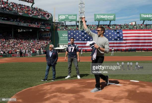 Tom Brady of the New England Patriots throws out a ceremonial first pitch at Fenway Park before an opening gay game between the Boston Red Sox and...