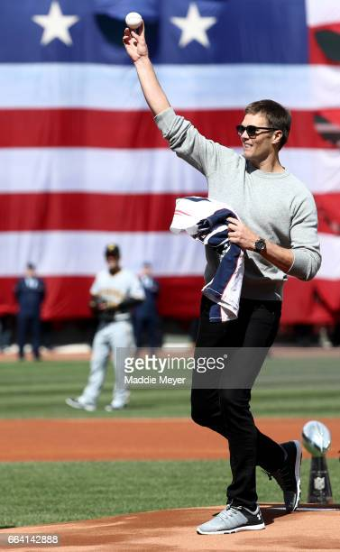 Tom Brady of the New England Patriots throws out the first pitch before the opening day game between the Boston Red Sox and the Pittsburgh Pirates at...
