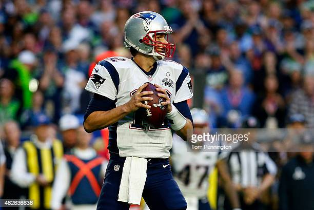 Tom Brady of the New England Patriots throws the ball against the Seattle Seahawks in the first quarter during Super Bowl XLIX at University of...