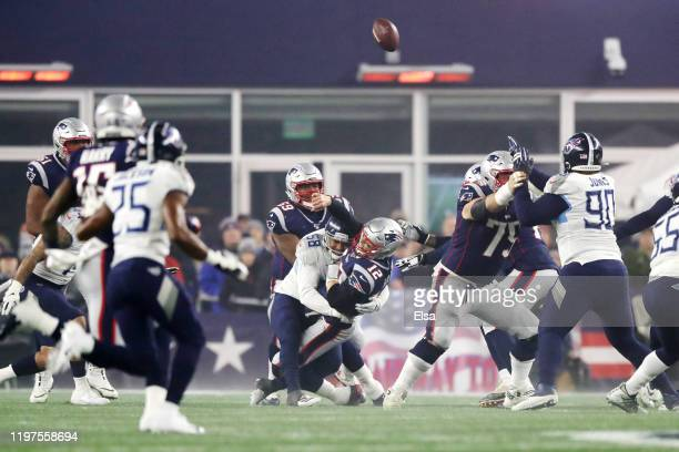Tom Brady of the New England Patriots under pressure against Harold Landry of the Tennessee Titans during the first quarter of the AFC Wild Card...