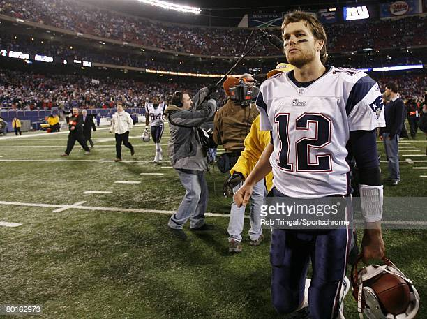 Tom Brady of the New England Patriots walks off the field after defeating the New York Giants during their game on December 29 2007 at Giants Stadium...