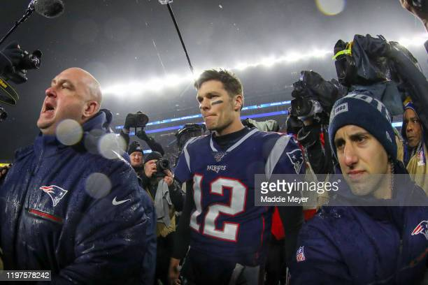 Tom Brady of the New England Patriots walks off the field after their 2013 loss to the Tennessee Titans during the AFC Wild Card Playoff game at...
