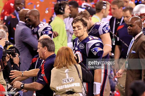 Tom Brady of the New England Patriots walks off the field after losing to the New York Giants in Super Bowl XLVI at Lucas Oil Stadium on February 5...