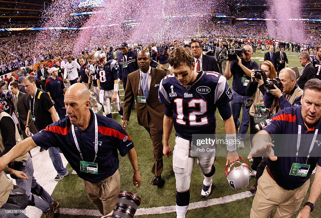 Tom Brady #12 of the New England Patriots walks off the field after losing to the New York Giants by a score of 21-17 in Super Bowl XLVI at Lucas Oil Stadium on February 5, 2012 in Indianapolis, Indiana.
