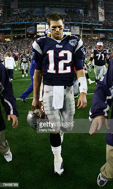Tom Brady of the New England Patriots walks off the field after losing to the New York Giants 17-14 in Super Bowl XLII on February 3, 2008 at the...