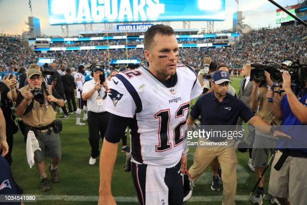 Tom Brady of the New England Patriots walks off the field following the New England Patriots 3120 loss to the Jacksonville Jaguars at TIAA Bank Field...