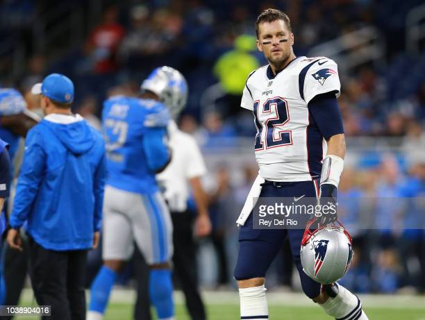 Tom Brady of the New England Patriots walks on the field prior to the start of the game against the Detroit Lions at Ford Field on September 23 2018...