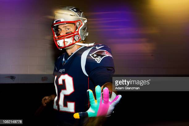 Tom Brady of the New England Patriots walks through the tunnel towards the field before a game against the Kansas City Chiefs at Gillette Stadium on...