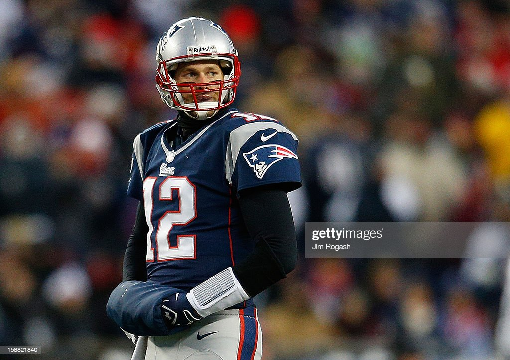 Tom Brady #12 of the New England Patriots walks to the sideline during a game with the Miami Dolphins at Gillette Stadium in the second quarter on December 30, 2012 in Foxboro, Massachusetts.