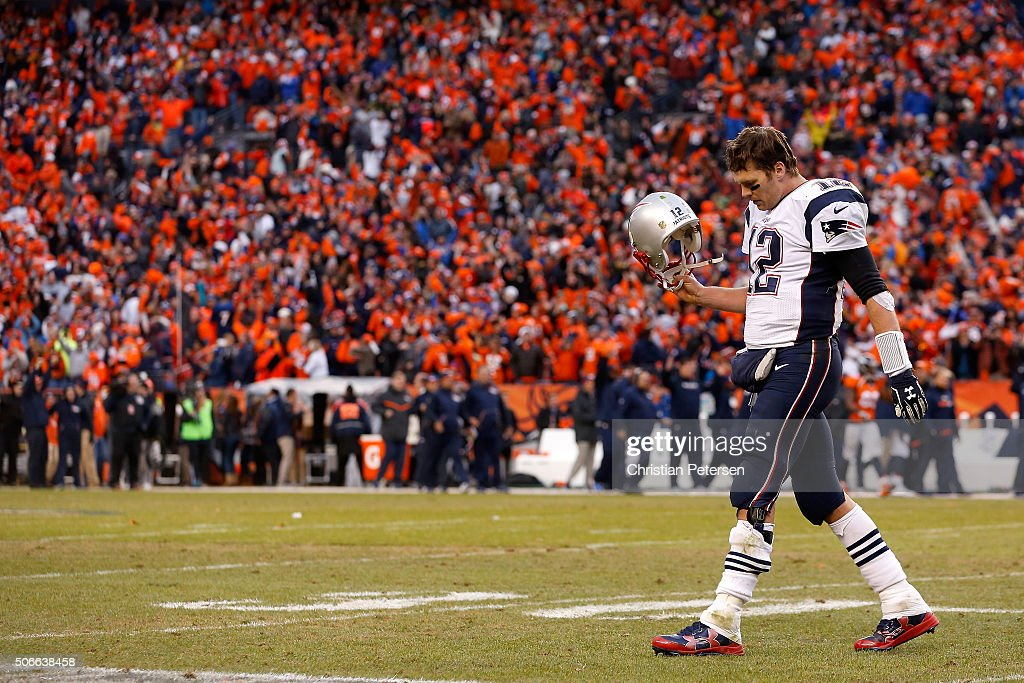 Tom Brady #12 of the New England Patriots walks to the sideline late in the fourth quarter against the Denver Broncos in the AFC Championship game at Sports Authority Field at Mile High on January 24, 2016 in Denver, Colorado.