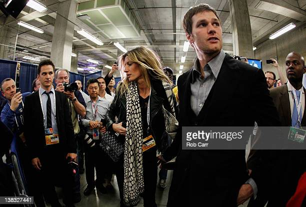 Tom Brady of the New England Patriots walks with his wife Gisele Bundchen after losing to the New York Giants by a score of 2117 in Super Bowl XLVI...