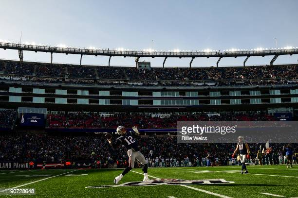 Tom Brady of the New England Patriots warms up before a game against the Miami Dolphins at Gillette Stadium on December 29, 2019 in Foxborough,...