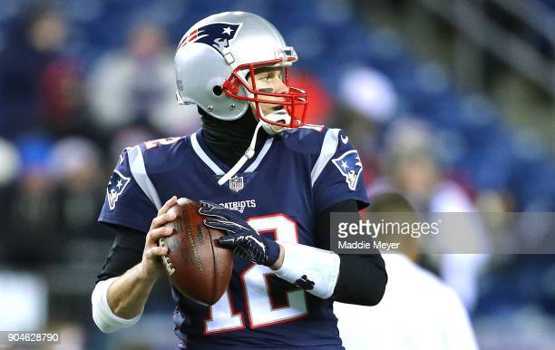 Tom Brady of the New England Patriots warms up before the AFC Divisional Playoff game against the Tennessee Titans at Gillette Stadium on January 13...