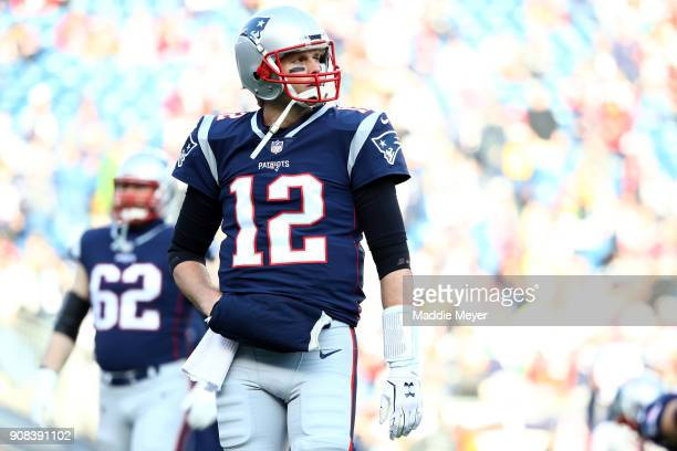 Tom Brady of the New England Patriots warms up before the AFC Championship Game against the Jacksonville Jaguars at Gillette Stadium on January 21...