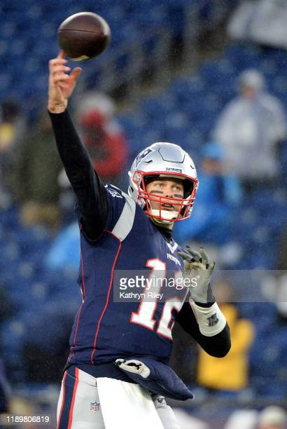 Tom Brady of the New England Patriots warms up before the game against the Dallas Cowboys at Gillette Stadium on November 24 2019 in Foxborough...