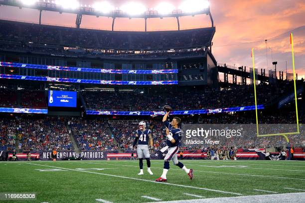Tom Brady of the New England Patriots warms up before the preseason game between the Carolina Panthers and the New England Patriots at Gillette...