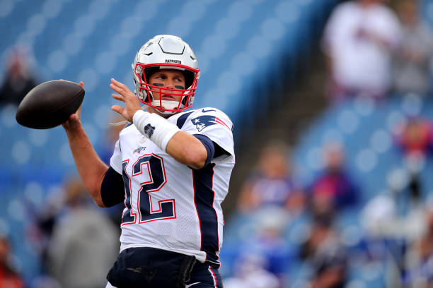 Tom Brady of the New England Patriots warms up prior to the game against the Buffalo Bills at New Era Field on September 29, 2019 in Buffalo, New...