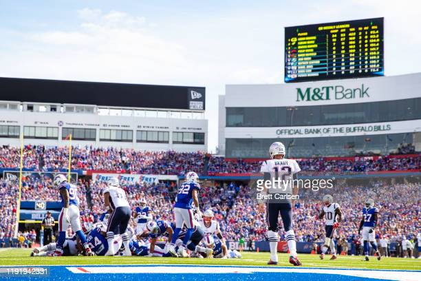 Tom Brady of the New England Patriots watches a play finish in front of him after a running play against the Buffalo Bills at New Era Field on...