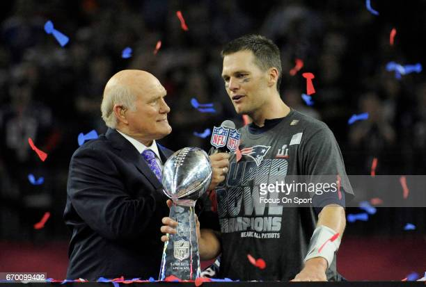 Tom Brady of the New England Patriots with the Vince Lombardi trophy talks with Fox analyst Terry Bradshaw after the Patriots defeat the Atlanta...